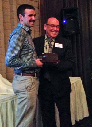Chamber Director Doug Pedlar presents Jesse Kadlecik with Entrepreneur of the Year award