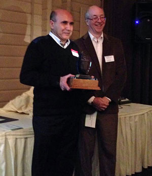 Past-President Glen Baillie presents Fadhil Askar with the Phyllis Statchuk Customer Service Excellence Award.