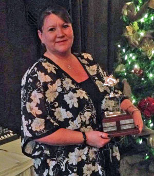 Office Manager Kylie Beattie accepts the Business of the Year Award for Track21 Graphix