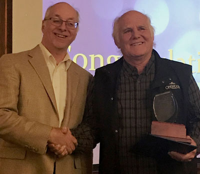 Chamber President Glenn Baillie presented the Phyllis Statchuk Customer Service Excellence Award to Leo Ducharme (of Oakwood Resort)